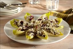 These Blue Cheese Cranberry Apple Endive Boats are so cute! Perfect for appetizers for a party.