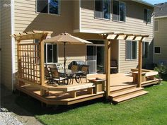 Don't care for the pergola thing, but kind of shows the combination of railing and benches that I like