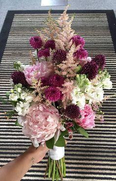 Bridal Bouquet Of Light Pink & Peonies, Light Pink Astilbe, Wax Flower, Purple Button Mums, White Stock Flower, & Maroon Bullet Allium