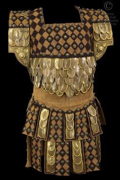 COSTUME DESCRIPTION:  Breastplate beige and brown skin with applications of gold metal flakes and pieces worked in silver metal. COMMENTS:  Costume also used in Iphigenia in Aulis, tragedy by Jean Racine Directed by Jules Truffier new presentation, Richelieu Room, October 29, 1911 Agamemnon Paul Mounet
