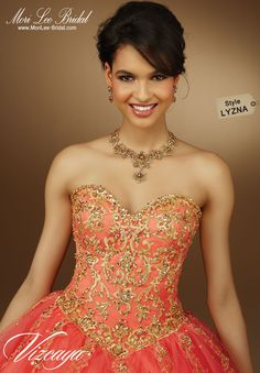 Style LYZNA EMBROIDERED TULLE QUINCEANERA GOWN WITH BEADING. Bolero Jacket. Corset Tie Back. Colors Available: Stiletto/Gold, Deep Purple/Gold, Champagne/Gold, White/Gold. Precio: $ 3.968.250 Pesos Colombianos / Precio: $1.202,5 Dólares Americanos