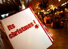 75998886-christmas-cards-are-displayed-with-christmas-themed