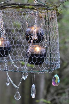 Turn a tomato cage into a gorgeous outdoor chandelier!