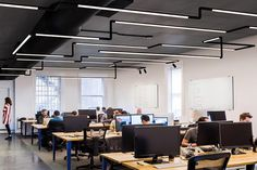 Pipeline 1 Power Warm Dim Downlight Suspension Center Feed by PureEdge Lighting Indirect Lighting, Lighting System, Lighting Design, Corporate Interiors, Office Interiors, Exposed Ceilings, Open Office, Office Lighting, Light Architecture