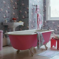 Can't you imagine taking a champagne bubble bath in that pink tub? Love it!