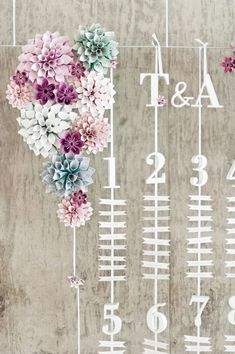 Suspended and hanging seating chart with paper cone flowers by eagle eyed bride Anushé Low Photography 2