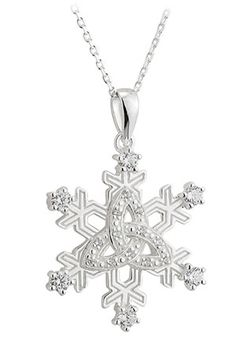 "Start with a sterling silver snowflake. Add a Celtic trinity knot for faith and heritage. Sprinkle with six cubic zirconia crystals for sparkle. And behold! Jewelry you'll love to wear on wintry days and special occasions. A beautiful set from a family-owned jewelry company in the heart of Dublin. Pendant and necklace: sterling silver; ⅞""d pendant on matching 18""l necklace. Silver hallmarked in Dublin Castle. Gift boxes."