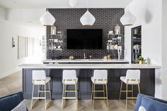 White finishings emphasizes black brick subway tiles at a wet bar with a TV flanked by brass and glass vintage bar shelves. Home Bar Rooms, Home, Home Bar Designs, Mediterranean Home, Basement Remodeling, Bars For Home, Bar Design, Home Bar Decor, Kitchen Design