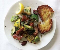 Grilled Sausage with Summer Squash, Fresh Herbs & Olives recipe - The possibilities for this dish are limited only by what you've got fresh on hand, so don't hold back—add other summer vegetables, like peppers, eggplant or sweet onions.