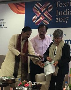 """Hon'ble Union Minister of State (I/C) for Tourism & Culture, Govt. of India releasing book of """"Handcrafted in India"""" alongwith Shri Rakesh Kumar, Executive Director, Export Promotion Council for Handicrafts (EPCH) and Ms Rosy Greenlees, President, World Crafts Council Int'l, U.K. - at Mahatma Mandir, Gandhinagar, Gujarat. #TextilesIndia17 #EPCHIndia"""