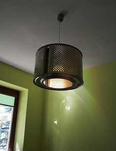 This industrial pendent is made using a washing machine barrel. How cool is that? The sky's the limit when it comes to pendent lighting. Hats, globes, baskets, bowls...