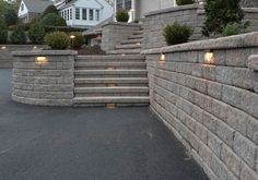 Our customer, Cashman Landscape Management & Design Inc., has created a very visually appealing entrance from driveway to front door by using Hickory Weathered Versa-Lok Block, and incorporating lighting into the retaining walls and steps.