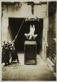 Houdini Being Lowered into the Upside Down, c. 1912