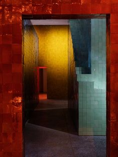 hermès presents new home collections within colorful, tile-clad chambers