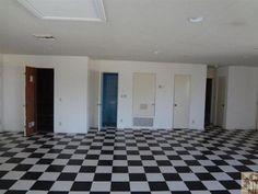 Inside former home of Elvis Presley. Looks like original floors.