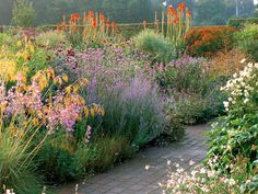 The perennial beds in a French-country garden offer an explosion of color — much like a Monet painting. Walkways may be flagstone, pea gravel or stone dust.