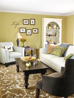 Love the shades of green and the conversation-conducive seating arrangement.