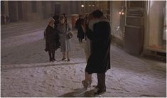 Bridget Jones kissing Mark Darcy in the snow