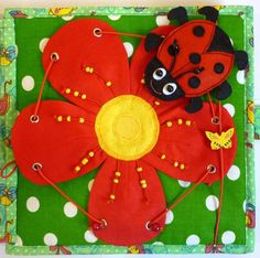 Open and close the flower w/cord and see the cute removable ladybug who lives inside.