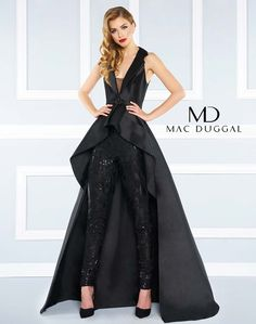 Satin jumpsuit with deep-v illusion neckline, peplum overskirt with beaded belt, and sequin pant.