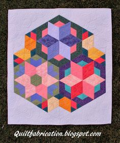 Multiple quilting designs on and around stars
