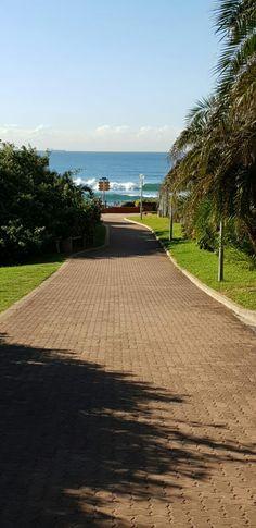 Path leading from the road to the beach and sea. North Coast, Paths, Sidewalk, Sea, Side Walkway, Sidewalks, Ocean, Pavement, Walkways