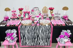 Pink and black dessert table at an animal print birthday party! See more party planning ideas at CatchMyParty.com!