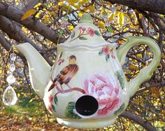 Tea Pot Bird Feeder....you can see two little eyes peeking out of the bird house!