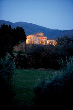 The grand Castello di Casole stands in all her glory like a beacon on the Tuscan hills. #JSSunrise   #Jetsetter