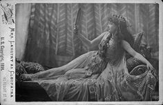 Title: [Lillie Langtry as Cleopatra, full-length portrait, lying on sofa and looking in mirror] Date Created/Published: London : Vanderweyde, c1891. Medium: 1 photographic print on cabinet card mount.