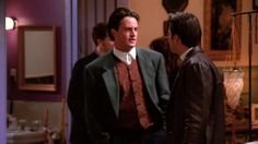 The one with the high-necked red vest. | Chandler Bing's 19 Most Heinous Outfits