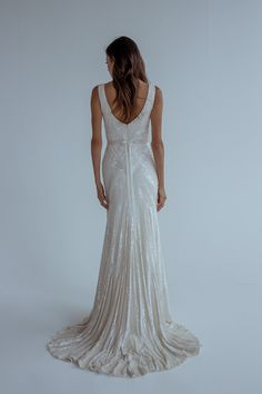 KAREN WILLIS HOMES // ONE & ONLY BRIDAL // The 'Fontanne' is a sheath wedding dress with a beautiful v-neck and back to match. The beading is linear, creating an elongating silhouette for the bride.