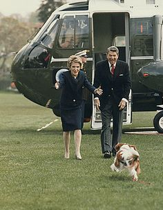 Nancy and Ronald Reagan get ready for their excited dog Rex to greet them as they disembark Marine One: