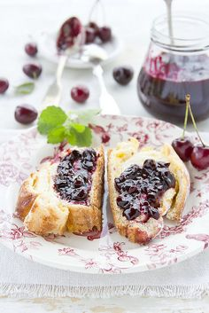 breakfast of fresh cherry jam on thick sliced toast.