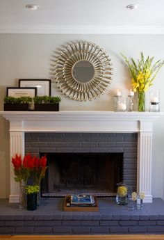 The dark color on the brick is Behr Anonymous, the white on the fireplace is Behr utltra bright white, and the light grey on the walls is Behr Dolphin Fin