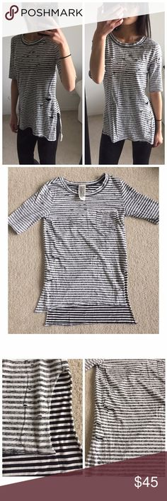 ⋙NEW LIST⋘ NWOT Free People BLK/WH Striped Top Free People black and white distressed striped shirt Cute and casual High low style. Front left pocket  New W/O Tags, never worn Size: XS 100% Cotton   If you would like to make an offer, please use the 'Offer' feature  ⟨Bundle & save ≫ One time shipping fee⟩ NO trades Free People Tops Blouses