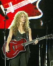 Shakira, a Colombian multilingual singer-songwriter, playing outside her home country. Globalization has affected the cultural sector and including the change in music and fashion.