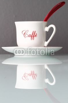 cup of coffee on a glass table, on @Fotolia