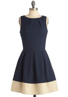 Pleated navy blue and white dress