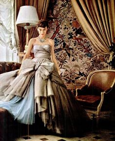 "In the sun room of Dior's house in Passy, Sophie Malgat wears the newest of Dior's ""big"" ball gowns, the skirt has 12 layers and is separate from the bodice because of its weight, photo by Mark Shaw, 1953"