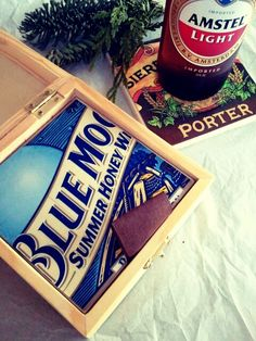 Beer coasters from tiles, wooden boxes and cardboard beer carriers.