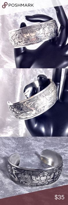 "Tibetan Buddhist BOHO Lotus Cuff Bangle Bracelet Tibetan silver unmarked cuff bangle with engraved traditional Buddhist motifs with lotus flower center and mystical birds bordering it. Filigree ornate design. 7.5"" x 1"". Art nouveau occult eastern philosophy Buddha spiritual pagan. Save the most by bundling. I offer 25% off on bundles of 2+ items. I accept reasonable offers on single items and bundles. Sorry I do not trade or offer holds. Boutique Jewelry Bracelets"