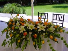 Centro de mesa para los novios de Florería el Paraíso en Quinta Pavo Real del Rincón www.pavorealdelrincón.com.mx