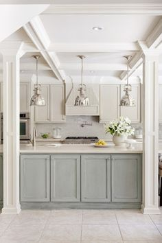 The paint colors in the kitchen are all by Sherwin Williams:   Trim – Shoji White SW7042   Island Cabinet (grey/blue) – Chatroom SW6171 with glazing finish   Perimeter Cabinets (grey/cream) – Wool Skein SW6148 with glazing finish   Wall – Wool Skein SW6148