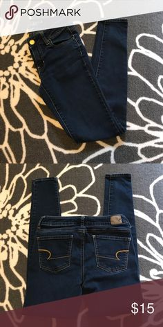 AEO Super Stretch Jegging Excellent condition!  No stains, tears, or signs of wear.  Inseam is 28 inches, waist measures 13 inches straight across, stretches to 15 inches.  Dark wash. American Eagle Outfitters Jeans Skinny