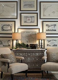 A dash of leopard print combined with sepia toned nautical prints and a shell encrusted cabinet.