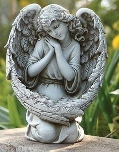 Guardian Angel Bird Feeder With Large Angel Wings. This angel is sure to attract the sweetest of birds. This pleasant Guardian Angel Bird Feeder is ideal for pa