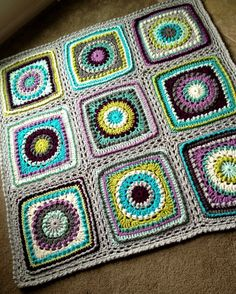 """Textured circles blanket tutorial by BabyLove Brand.-2 strands worsted weight yarn-10mm hook-16 motifs= 68"""" square"""