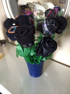 "Mens ""Flower"" bouquet  What you need:  Flower ""Pot"" Scissors Tape Green Tissue Paper Bobbi-Pins Skewers Green Foam Underwear, Socks, Ties"