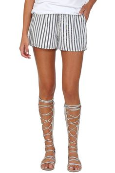 Black and white striped flowy shorts featuring dual side pockets and stretch waistband. These shorts have a super cute boxer look and will make for the perfect casual cool outfit.